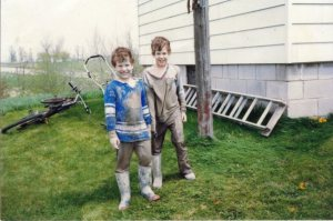 Me and Nicholas returning home from a muddy adventure.