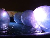 People were actually velcroed into these bubbles, which were then SEALED and inflated, and pushed out onto the pool of water!