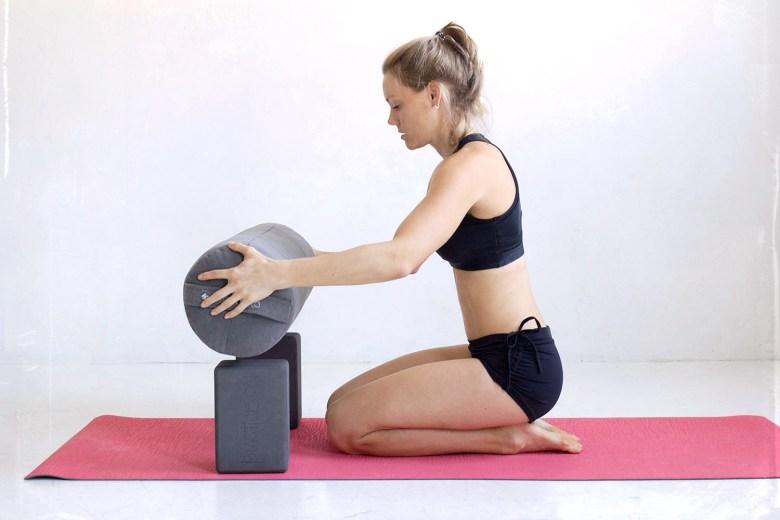 in home yoga studio with manduka eko lite yoga mat and manduka yoga blocks and round bolster