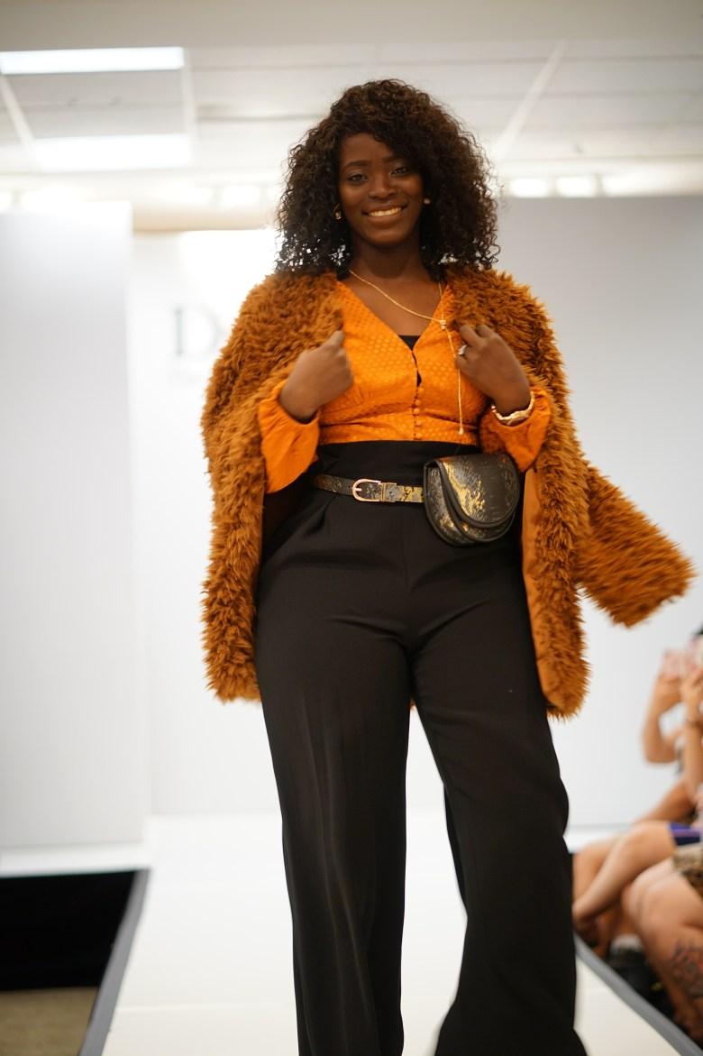 snake print belt bag and orange blouse outfit