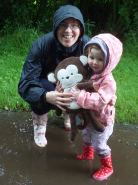 Mommy, Amélie and Monkey in a puddle