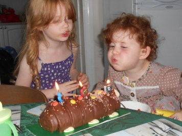 Amélie blowing out her candles