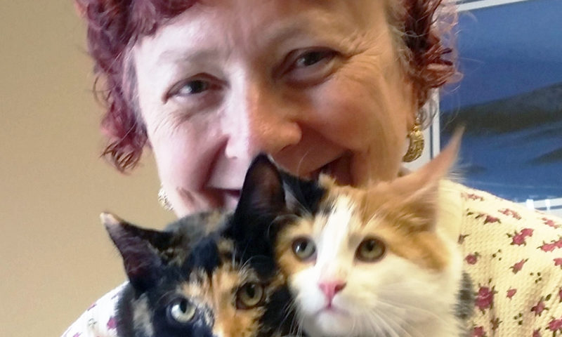 The Founder of Fur Love Comfort Cats with Two of Her Felines