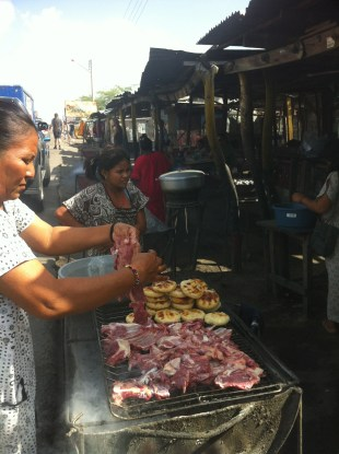 Grilled goat and arepas in the market