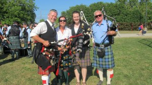 Bob Fillies (on rt) with other participants in AHG Reunion Pipe Band. (Bob is playing John Walsh's full silver pipes.)