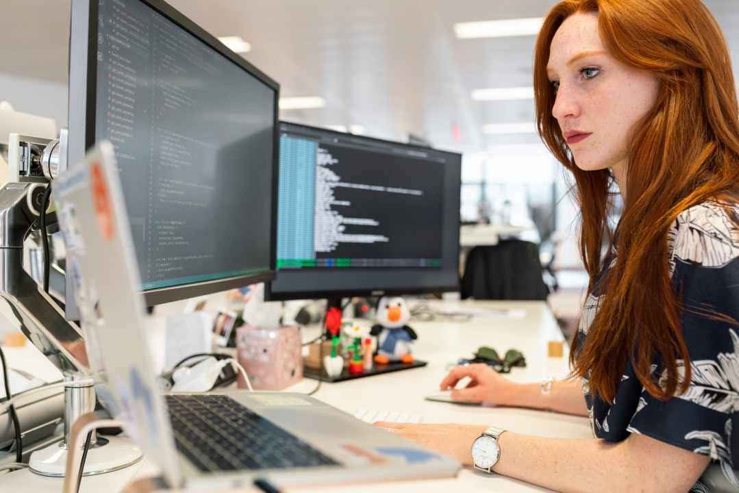 woman coding on computer