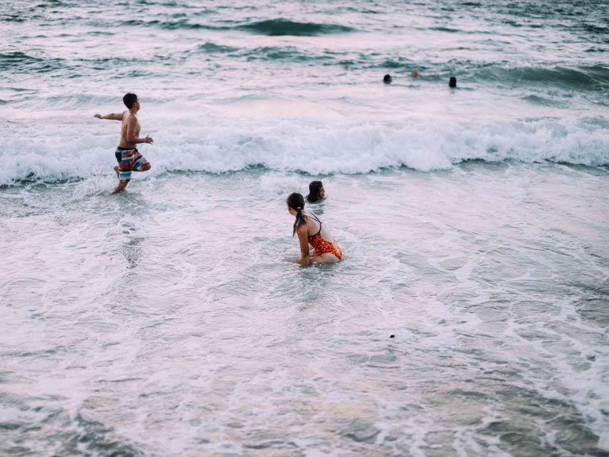 people enjoying vacation in foaming sea