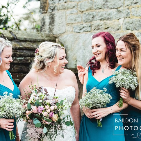Bridesmaids smiling and happy in the grounds at Holdsworth House in Halifax