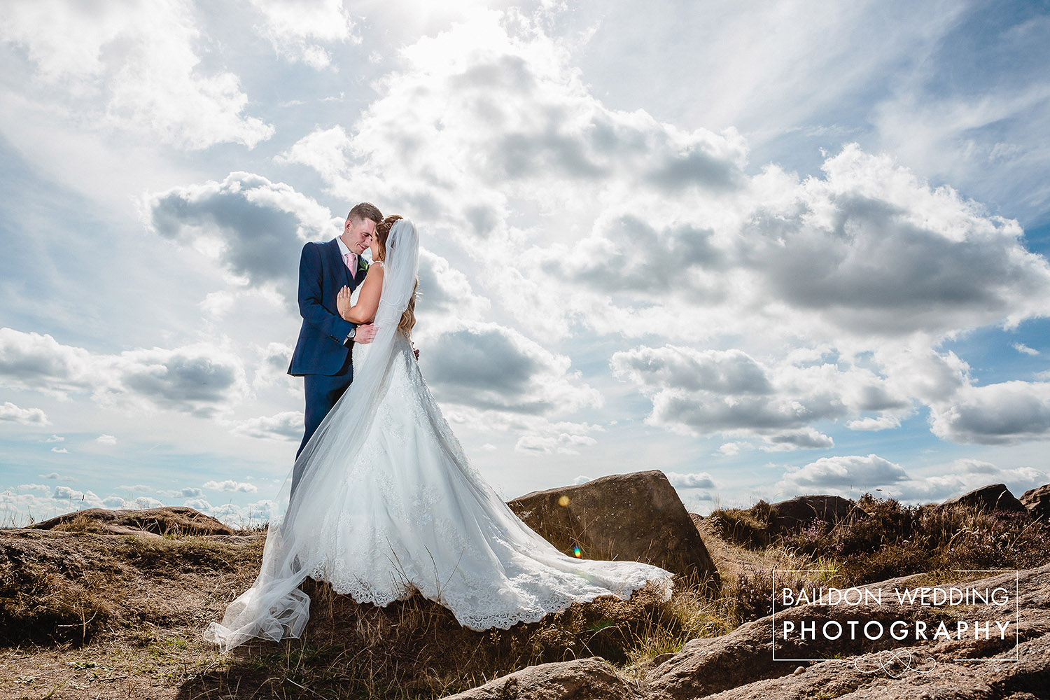 Newlyweds married at Leeds wedding venue Otley Chevin photographed with clouds
