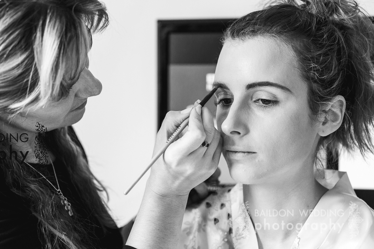 bride having her make-up applied on the morning of her wedding day