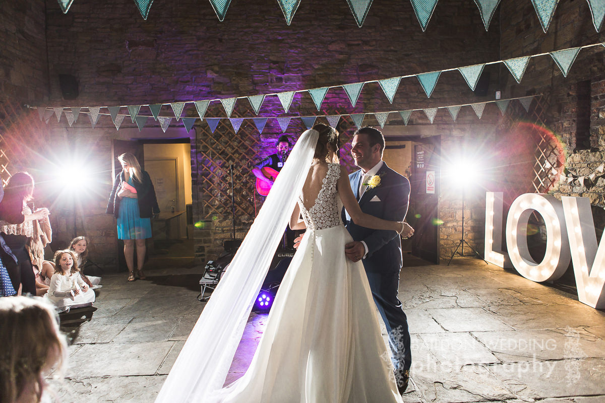 Bride and groom during their first dance at the rustic wedding venue Oakwell Hall in Yorkshire