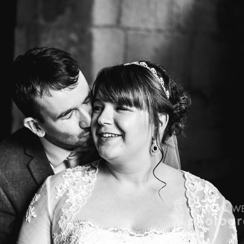 Black and white wedding picture in the ruins of Kirkstall Abbey just outside Leeds city centre