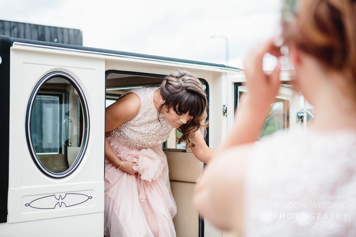 Bridesmaid arrives