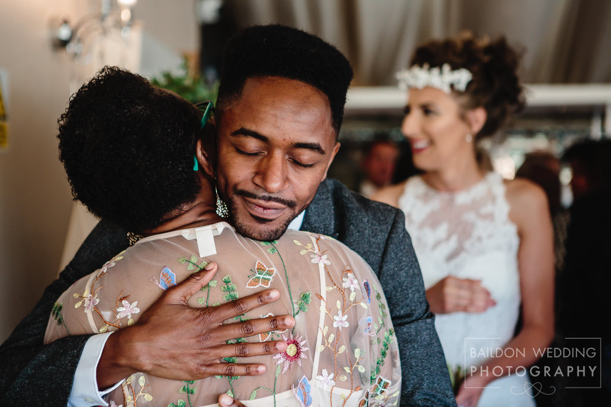 Groom embraces family