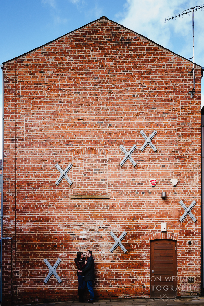 Wedding photography Northern Monk Brewery red brick building as backdrop for couple shot