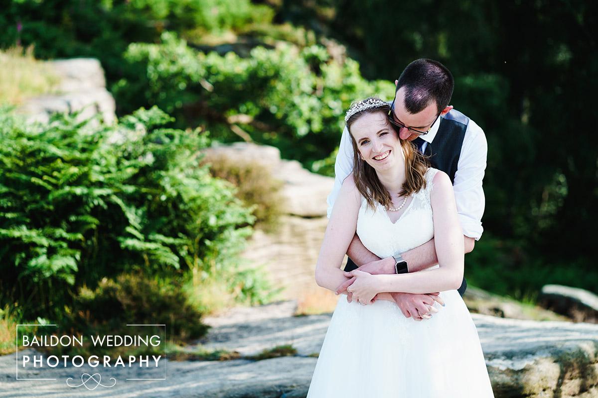 couple embrace Oakwood Hall Bingley wedding
