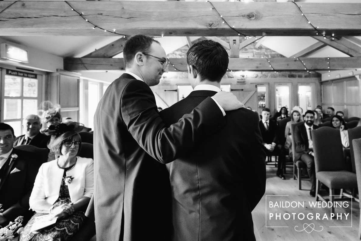 Best man comforts a nervous groom before the wedding ceremony