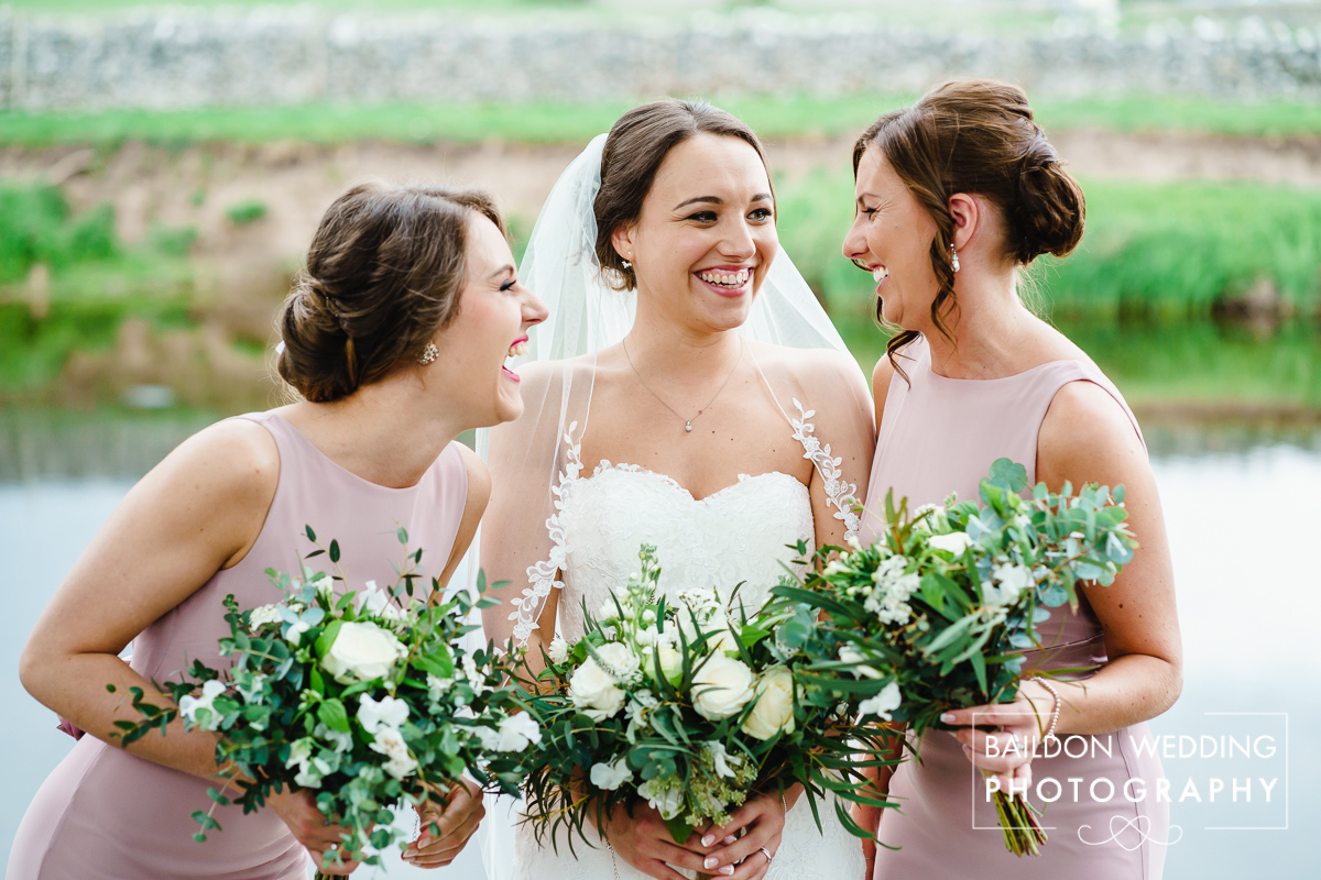 Bride and bridesmaids with bouquets of white flowers
