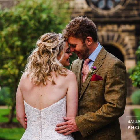 Bride and Groom embrace during golden hour during styled shoot at East Riddlesden Hall