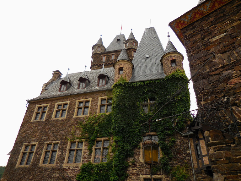 Reichsburg courtyard with part of castle covered in ivy