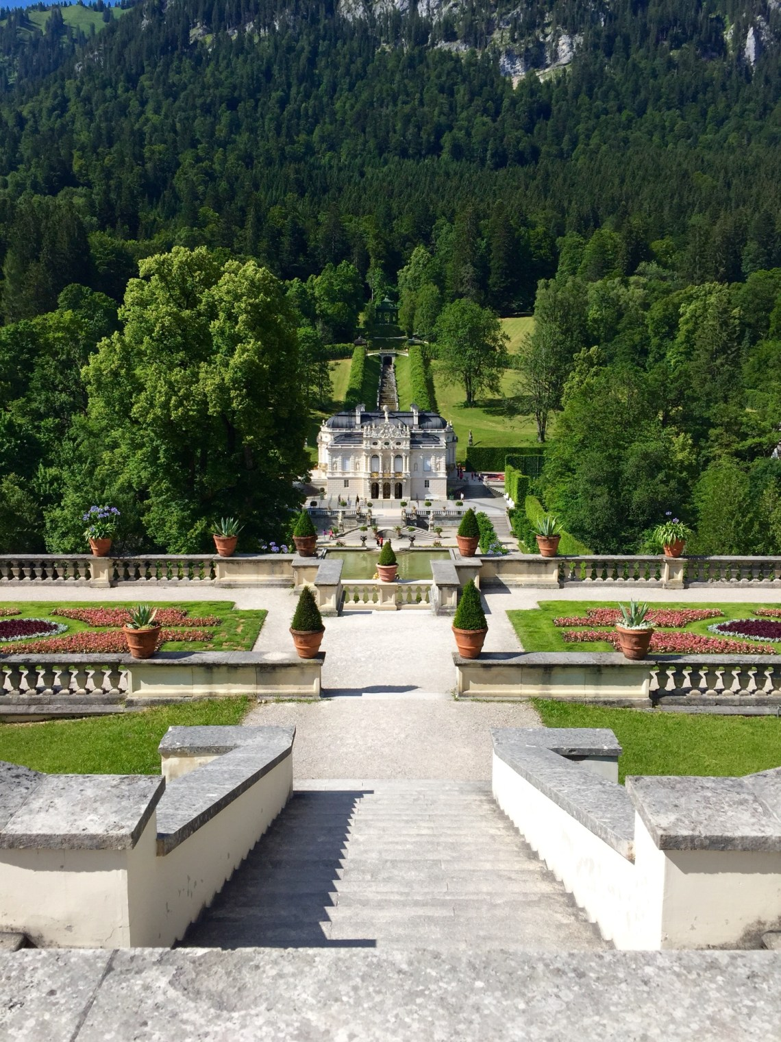 view of Linderhof Palace from above steps