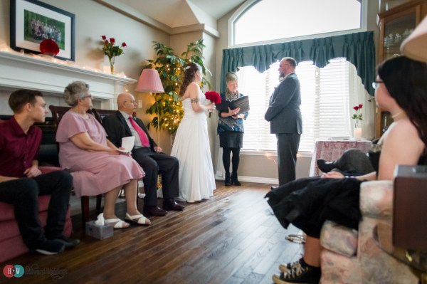 Home ceremony with bride and groom standing