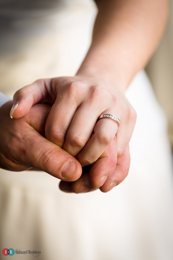 Hands holding with wedding rings