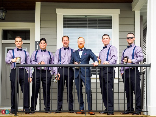 Groom and groomsmen in a line standing on deck