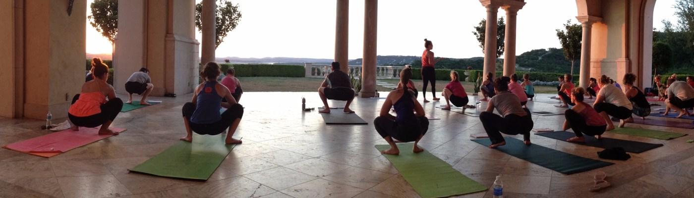 sunset yoga class under a pavilion