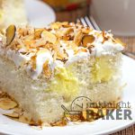 Toasted almonds and velvety coconut cream flavor this doctored poke cake.