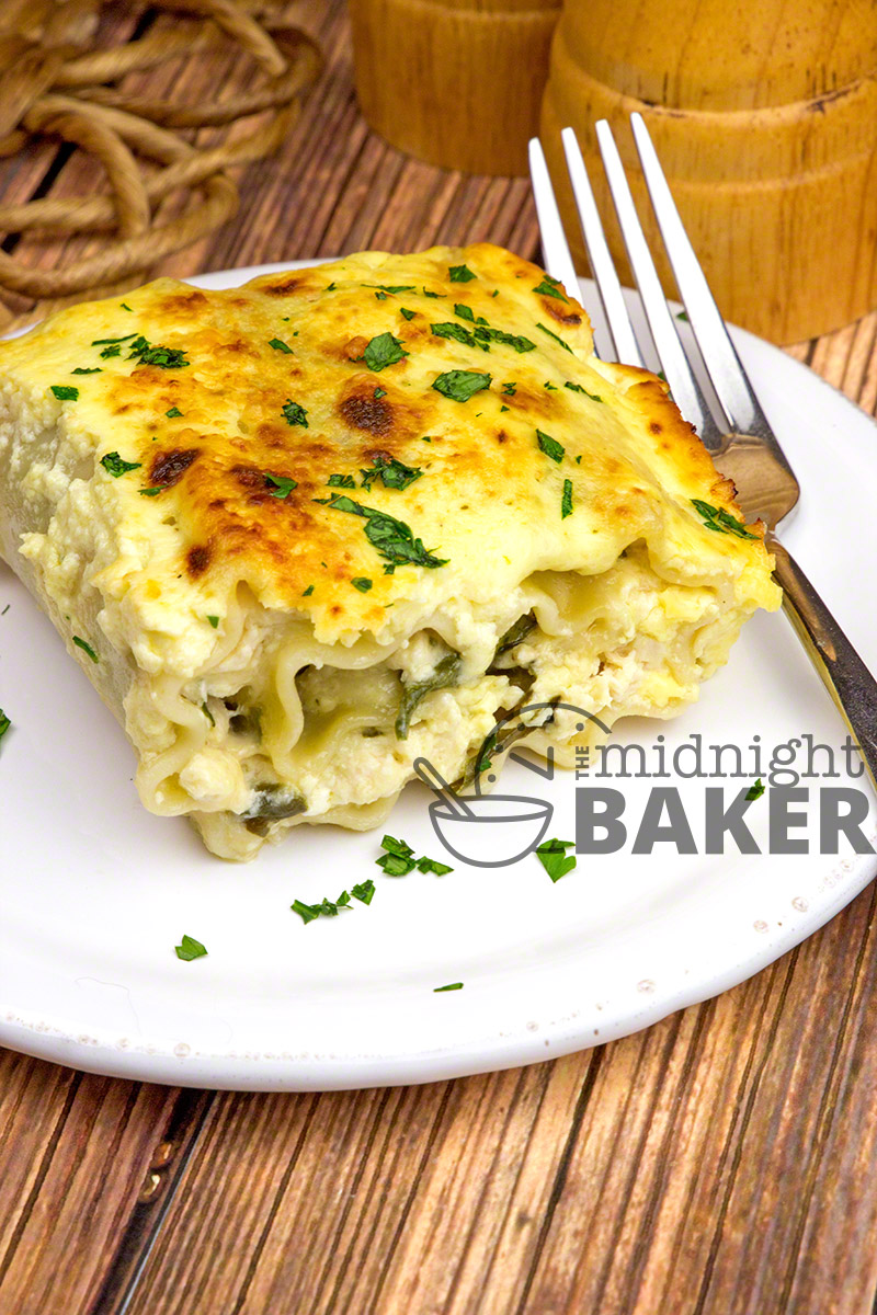 Here's something different to do with that leftover chicken! Lasagna noodles filled with a creamy chicken and spinach filling topped off with a rich, yet easy. alfredo sauce.