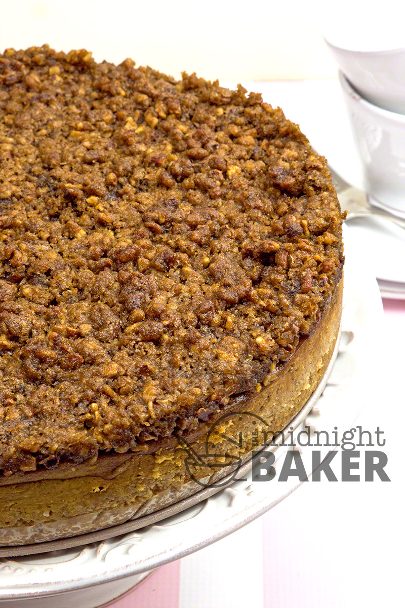 This creamy pumpkin cheesecake with a to-de-for praline topping is a perfect holiday dessert.