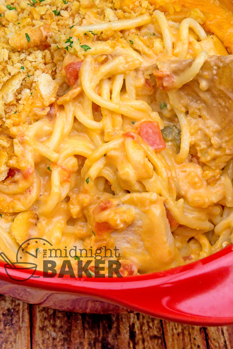 Cheesy chicken spaghetti casserole with spicy rotel tomatoes in the sauce.