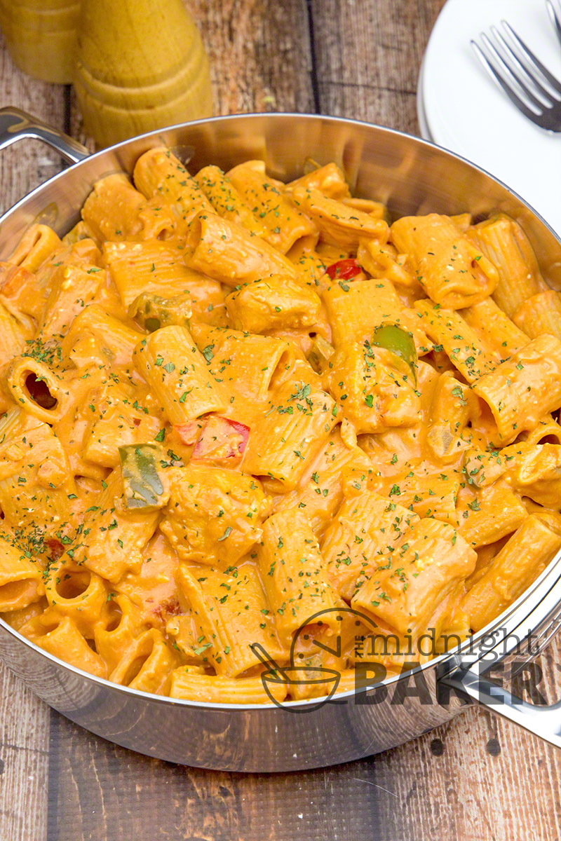 Chicken riggies is a famous dish from the Utica/Rome region of New York. It's a hearty pasta dish with marinated chicken and rigatoni in a rich tomato cream sauce. YUM!