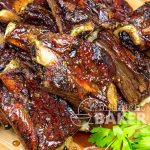 Succulent beef ribs with an orange maple glaze.