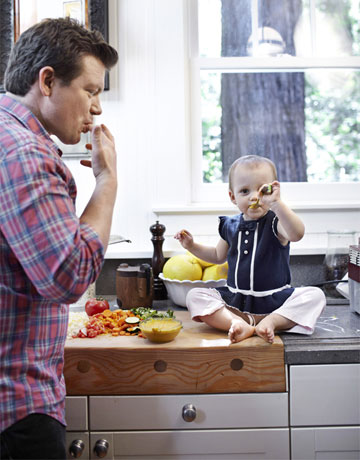 tyler florence in the kitchen with his two year old daughter