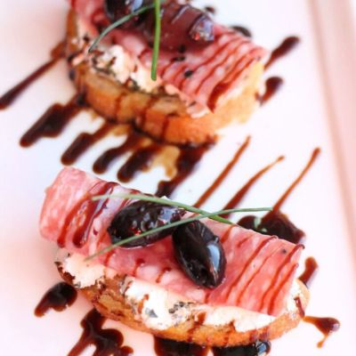 Salami & Herbed Goat Cheese Crostini with Kalmata Olives & Balsamic Glaze