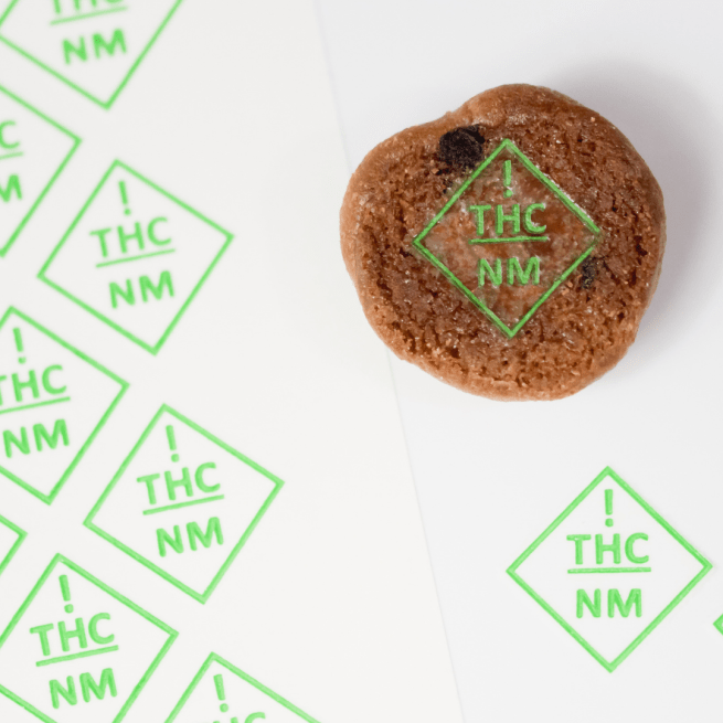 a cookie embossed with new mexico thc symbol