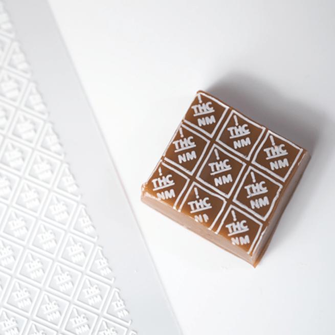 Caramel with white New Mexico THC symbols
