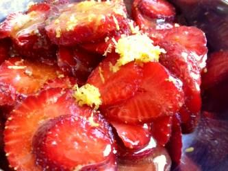 strawberries in lemon juice and zest