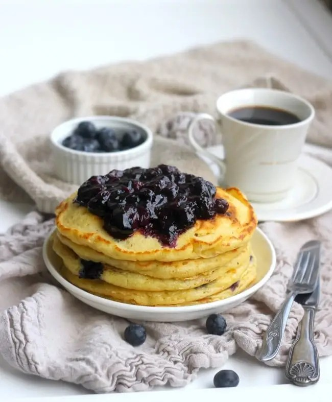 """These fluffy blueberry buttermilk pancakes really live up to the """"cake"""" party of their name. They are incredibly tender and light and filled with fresh blueberries. Whatever you call them: pancakes, hotcakes, flapjacks or griddle cakes, these will quickly become a favorite breakfast!"""