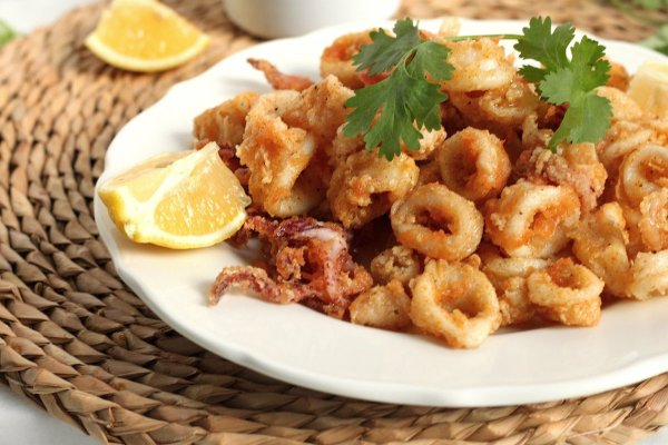 Fried Calamari with Tabasco and Honey Drizzle and Cilantro