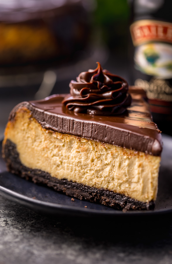Love Baileys Irish Cream Liqueur? Crazy for cheesecake? Well then you have to try this Baileys Irish Cream Cheesecake! Featuring a chocolate cookie crust, creamy Baileys Irish Cream Cheesecake filling, and a thick layer of chocolate ganache. It's out of this world flavorful! And it's the perfect St. Patrick's Day dessert!