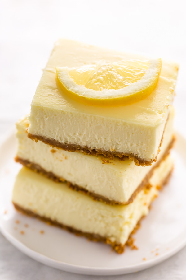 Easy Lemon Cheesecake Bars are perfect for almost any occasion! Made with fresh lemon juice, lemon zest, cream cheese, and sour cream, they're tangy, sweet, and so delicious. A must try for lemon lovers!