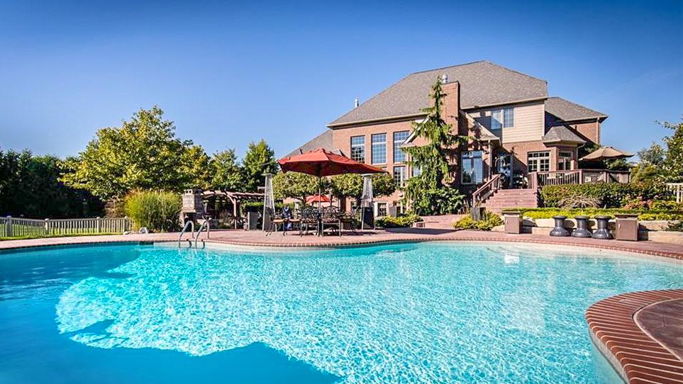 Resort-like Rear Yard Pool Desk with Hot Tub