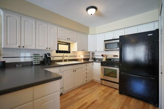 Kitchen - updated cabinetry & backsplash
