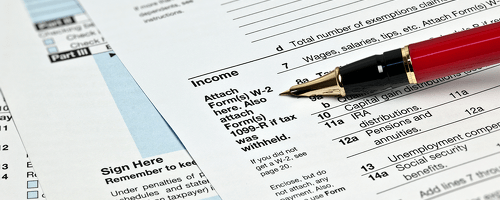 tax form with red pen