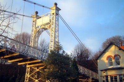 Queens Park footbridge in Autumn light