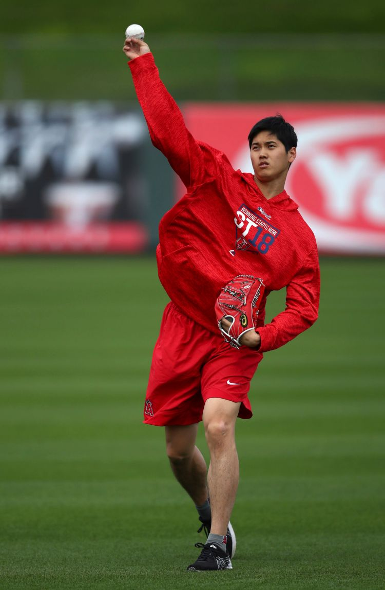 Ohtani reports to Angels with physical, swings and long ...