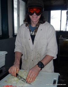 Joe demonstrating his technique for cutting onions for sausage. Every batch of sausage is individually mixed, with no MSG or other chemical additives.